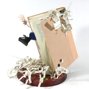 Book sculpture that appears as though it has a person inside trying to get out